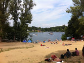 Sunbathers enjoying a sunny day on the beach at Muggelsee