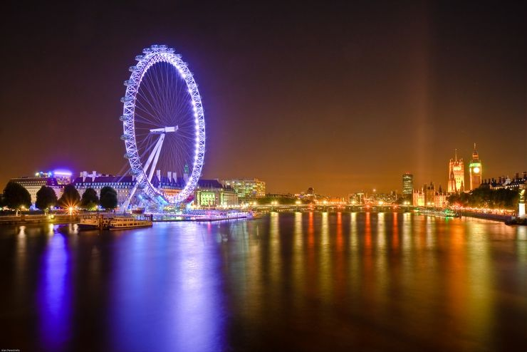The Huge London Eye Rotating Slowly Above the River Thames at Dusk