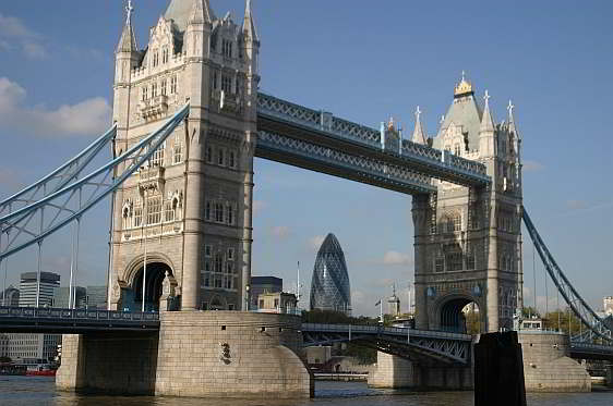 View of London's famous Tower Bridge framing the 40 storey Gherkin Tower