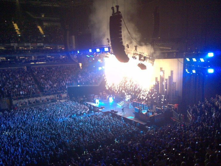 Fans enjoying a live concert inside London's O2 Arena