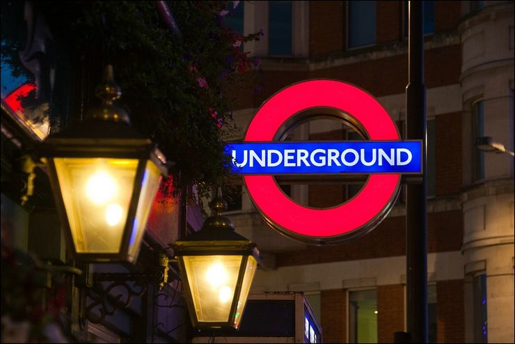 The very familiar sign indicating a station entrance along the London Underground