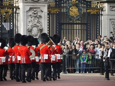 Visitors enjoy an upclose view of the Changing of the Guards in front of the gates of Buckingham Palace