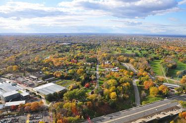 View to the west on a beautiful autumn day with Montreal Botanical Garden in the foreground