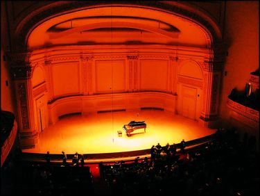 Concert Grand on the stage of Caregie Hall awaits the pianist
