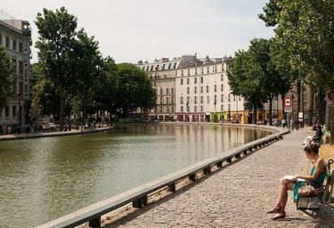 People enjoying a sunny day along the banks of Canal Saint-Martin