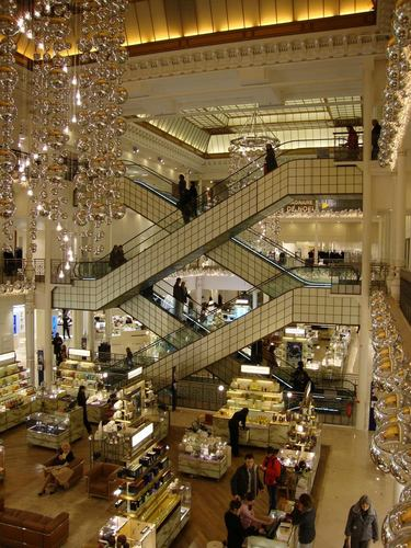 Escalators will get you to the many levels of shopping in Le Bon Marche