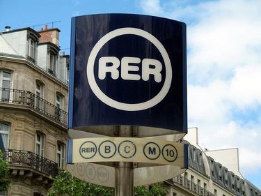 Sign indicating an RER Station the serves line B and C as well as line 10 on the Metro