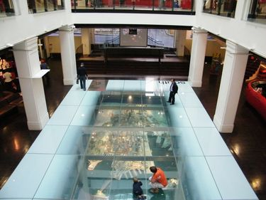 Visitors check out the spectacular model of Sydney under the glass floor inside the Customs House