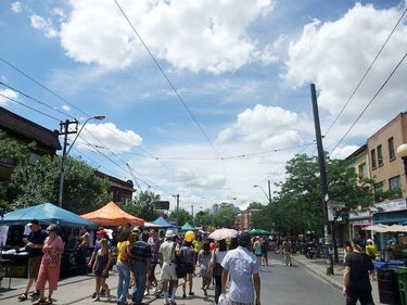 People enjoying Little Italy along College Street West during the Taste of Little Italy event