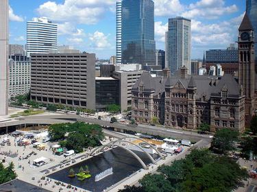 A view of Nathan Phillips Square with Toronto's Old City Hall in the background