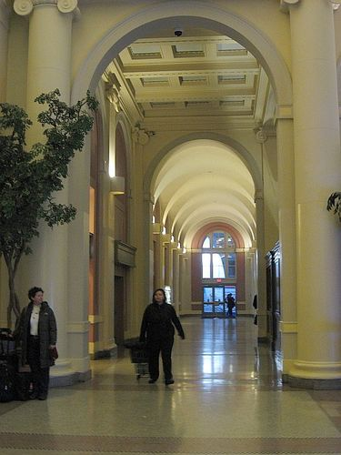 Symmetric Arches and Columns Leading into the Main Hall of Waterfront Station