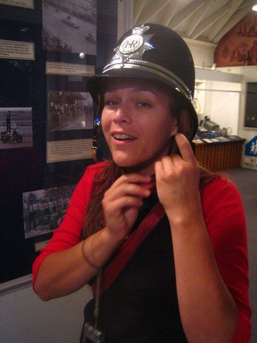 Trying on an old police officers hat