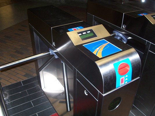 Fare reader and turnstile on the Montreal Metro. If you are using the Occasional fare card just place it against the card outline on the blue square at the top of the turnstyle.