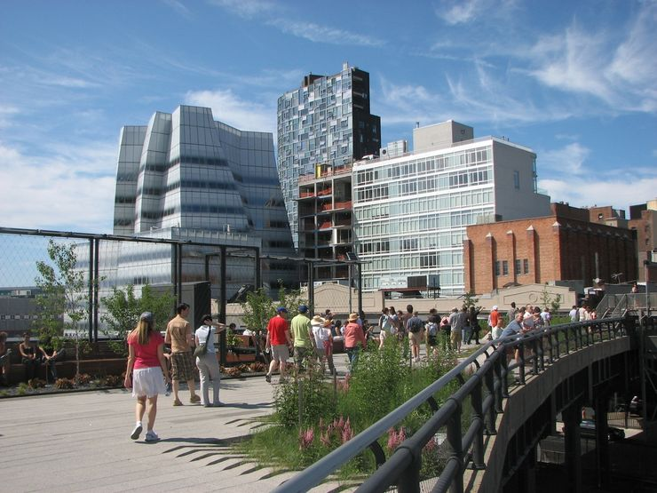People enjoying a stroll through High Line Park in New York City