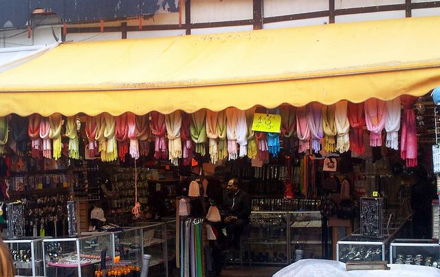 Colorful goods hang is a stall at Le Marché aux Puces de St-Ouen in Paris