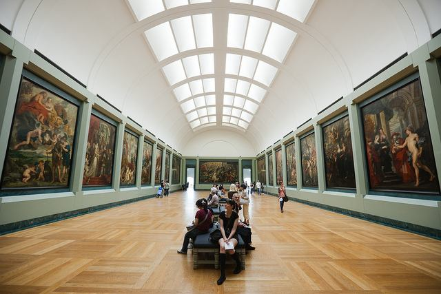 One of many expansive halls exhibiting paintings by the masters inside The Louvre
