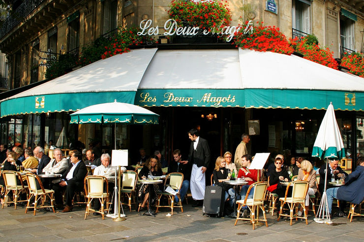 Sidewalk cafes are very popular in Paris