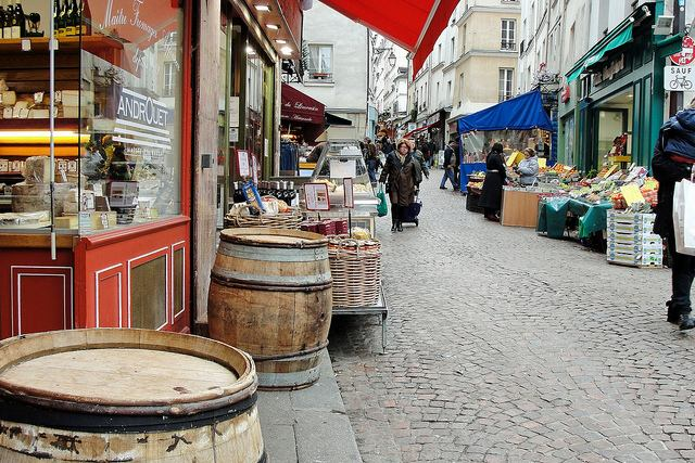 Colourful shops and stalls lining Rue Mouffetard Market