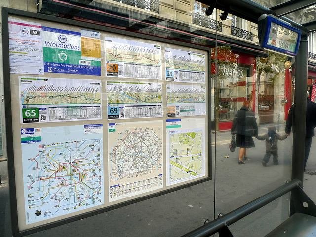 Very helpful signage and maps in a Paris bus stop shelter