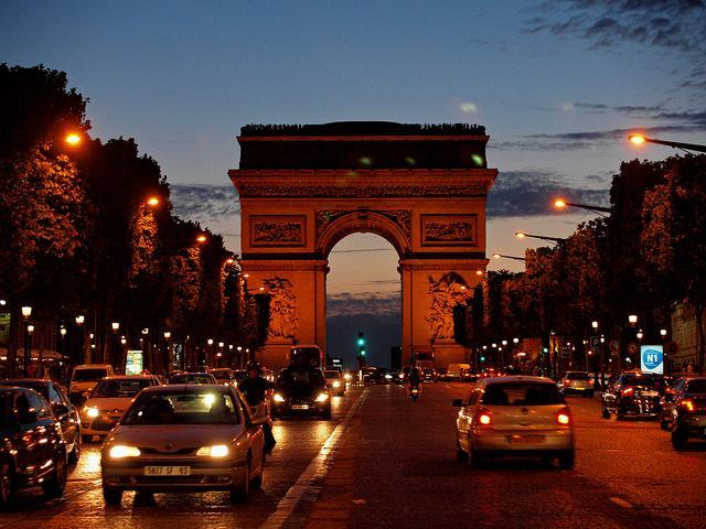 Dramatic view of the Arc de Triomphe at dusk