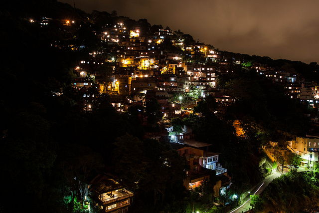 Cloaked in the darkness of night the lights of the favelas can actually look beautiful