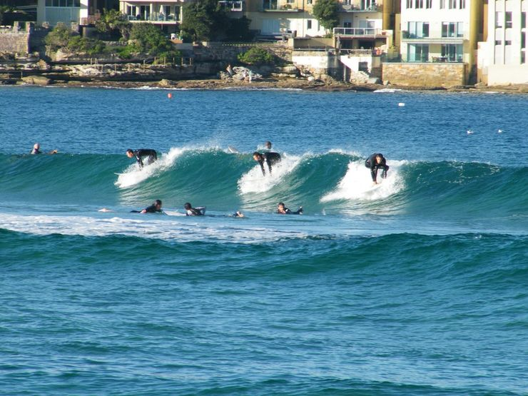 Surfers catching a wave at Bondi Beach