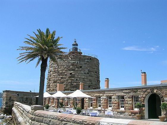 View of Fort Denison with the dining terrace in the foreground and the Martello tower in the background