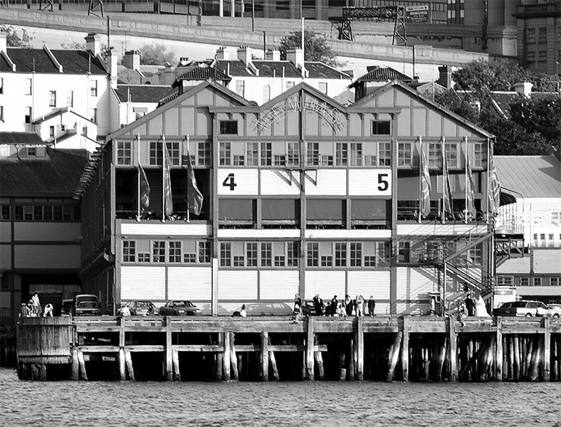 The Historic Wharf Theatre as seen from the harbour