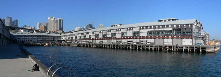 Panoramic view of the Wharf Theatre from an adjacent pier