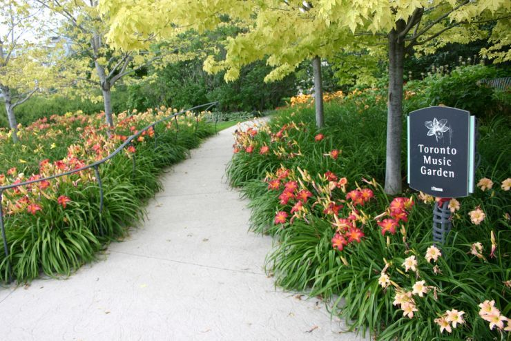 A flower lined pathway invites visitors into the Toronto Music Garden