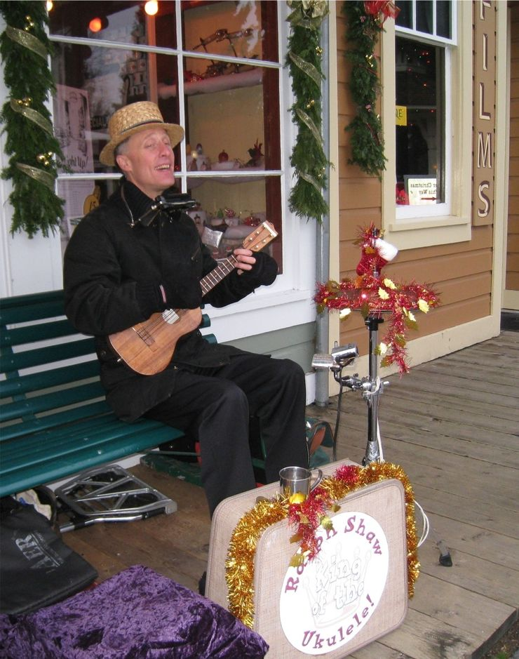 A banjo player entertains guests at the Burnaby Village Museum