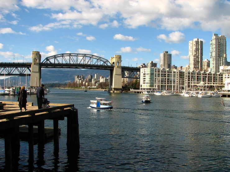 A False Creek Ferry Passing Granville Island with Burrard Street Bridge in the background