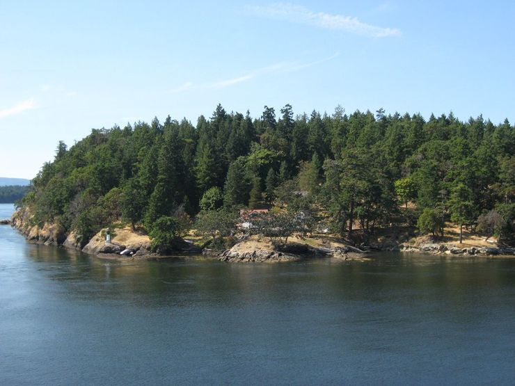 Home and a small lighthouse on the southern tip of Galiano Island