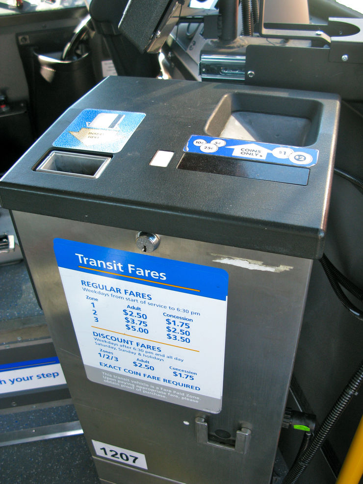 CMBC Bus Farebox - Lightly insert your ticket or pass into the top left slot with the arrow down and the magnetic strip facing you. The ticket will be returned to you immediately and the farebox will indicate the validity to you and the operator