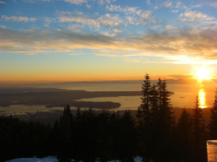 Spectaular sunset view of Vancouver and beyond from Grouse Mountain