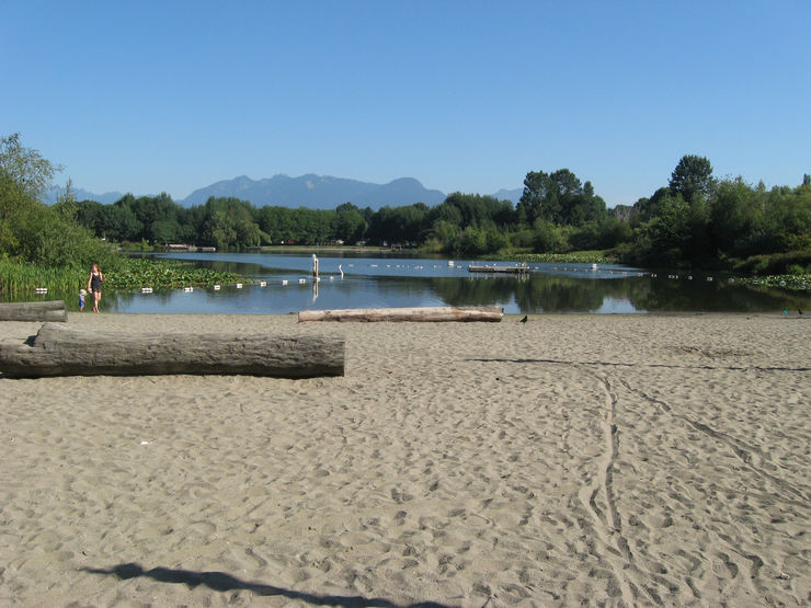 A sandy beach flanks the south end of Trout Lake in John Hendry Park