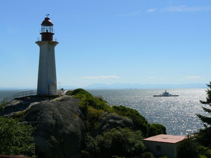 A BC Ferry passes by the Lighthouse in Lighthouse Park