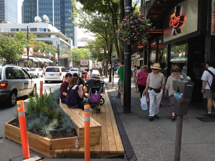 People enjoying a nice day along Robson Street in Vancouver
